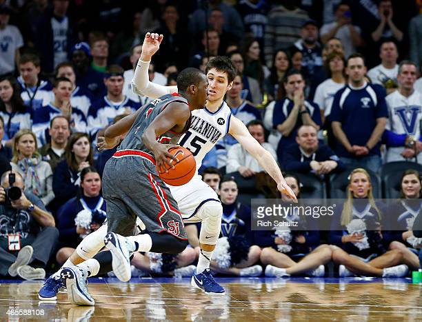 Phil Greene IV of the St Johns Red Storm is guarded by Ryan Arcidiacono of the Villanova Wildcats during the second half of an NCAA college...