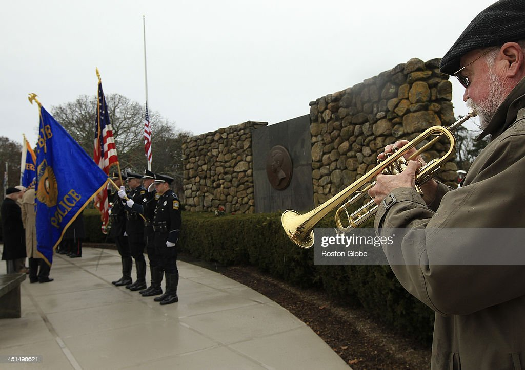 Phil Hagee, principal trumpet for the Cape Cod Symphony Orchestra, plays during a wreath laying ceremony at the John F. Kennedy Memorial in Hyannis, Mass., Nov. 22, 2013, 50 years after the assassination of President John F. Kennedy.