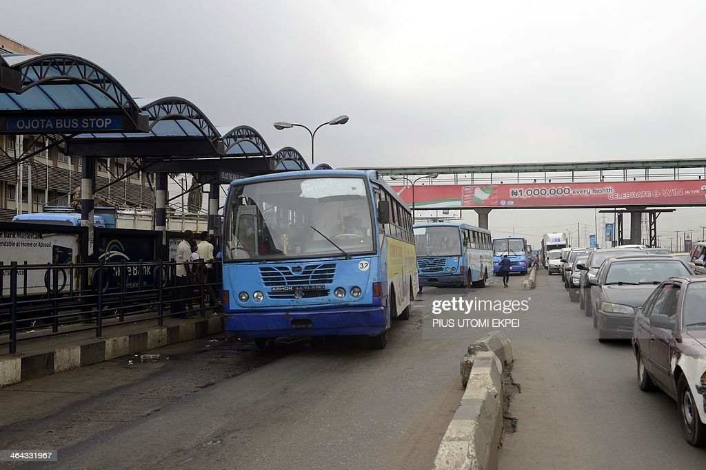 Phil HAZLEWOOD Commuters board Bus Rapid Transit (BRT), which relies on the use of dedicated interference free segregated lanes to guarantee fast bus travel to beat the traffic in Lagos on January 22, 2014. Workers in Lagos, Nigeria's commercial capital get up as early to travel to work, knowing that if they leave it any later the traffic will be gridlocked. Even so, it can still take them up to four hours to get to work and they then have to leave mid-afternoon to make the long trip home. So, at least eight hours a day or 40 hours a week, all spent in traffic jams in a car or a bus because there's no other option.