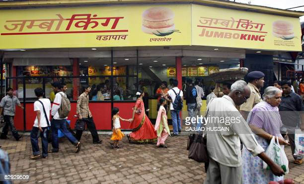 Phil Hazlewood Indian pedestrians walk past a Jumbo King food outlet in Mumbai on September 20 2008 Dheeraj Gupta is a man with a big vision to take...