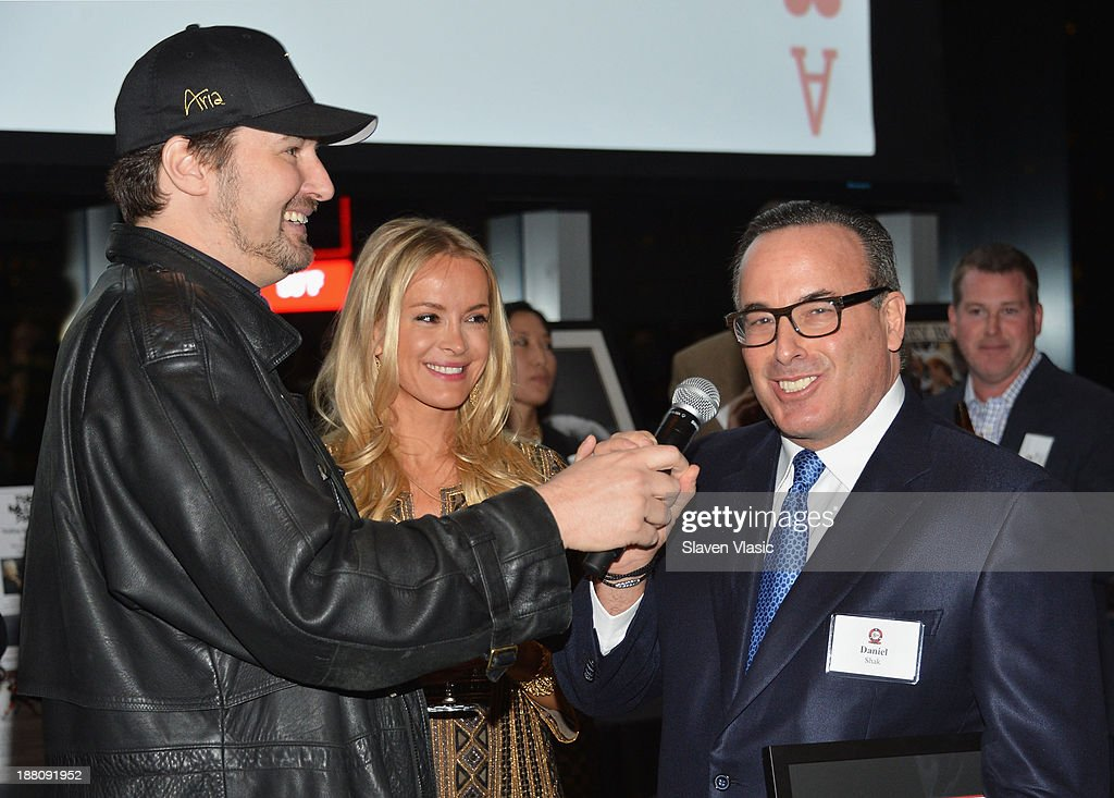 <a gi-track='captionPersonalityLinkClicked' href=/galleries/search?phrase=Phil+Hellmuth&family=editorial&specificpeople=810515 ng-click='$event.stopPropagation()'>Phil Hellmuth</a>, Anna Shak and Dan Shak attend The Children's Hospital Of Philadelphia & World Poker Tour 'All In' For Kids Poker Tournament at Mandarin Oriental Hotel on November 14, 2013 in New York City.