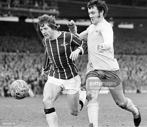 Phil Hoadley of Crystal Palace clashes with Ray Kennedy of Arsenal during their Division One football match at Selhurst Park in London on 13th March...