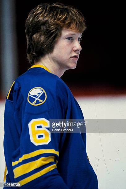 Phil Housley of the Buffalo Sabres looks on during warmups a game against the Montreal Canadiens Circa 1980 at the Montreal Forum in Montreal Quebec...