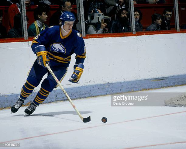 Phil Housley of the Buffalo Sabres skates with the puck during a game against the Montreal Canadiens Circa 1980 at the Montreal Forum in Montreal...