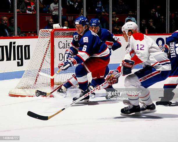 Phil Housley of the Winnipeg clears the puck away from his net against the Montreal Canadiens in 1991 at the Montreal Forum in Montreal Quebec Canada