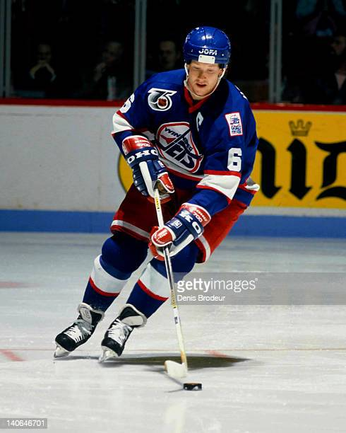 Phil Housley of the Winnipeg Jets skates with the puck against the Montreal Canadiens in 1991 at the Montreal Forum in Montreal Quebec Canada