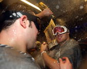 Phil Hughes and Joba Chamberlain of the New York Yankees celebrate with the trophy in the locker room after their 73 win against the Philadelphia...