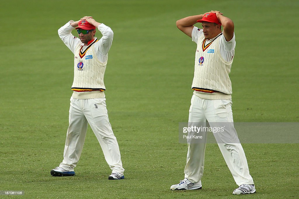 Phil Hughes and Trent Lawford of the Redbacks look on in the slips during day one of the Sheffield Shield match between the Western Australia Warriors and the South Australia Redbacks at the WACA on November 6, 2013 in Perth, Australia.