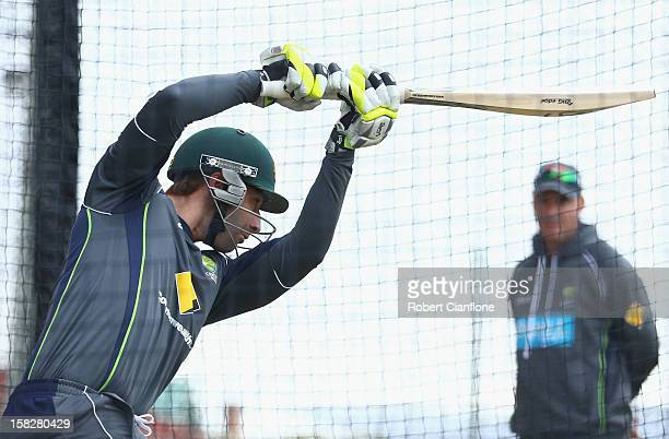 Phil Hughes of Australia bats as coach Mickey Arthur looks on during an Australian nets session at Blundstone Arena on December 13 2012 in Hobart...