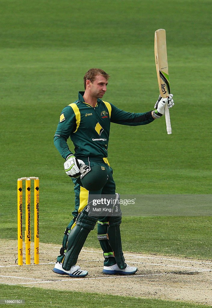 Phil Hughes of Australia celebrates scoring a century during game five of the Commonwealth Bank One Day International series between Australia and Sri Lanka at Blundstone Arena on January 23, 2013 in Hobart, Australia.