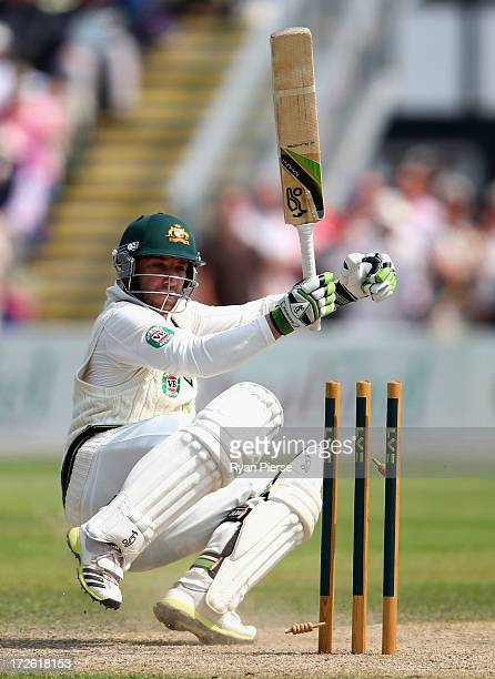 Phil Hughes of Australia is bowled by Chris Russell of Worcestershire during day three of the Tour Match between Worcestershire and Australia at New...