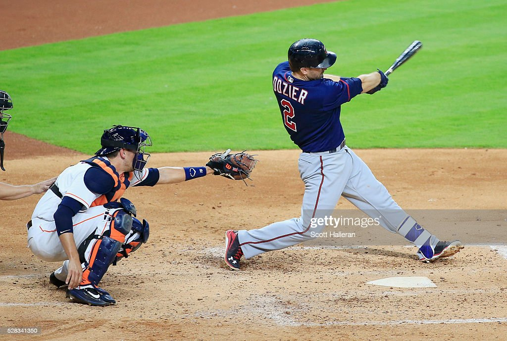 Phil Hughes of the Minnesota Twins connects on a threerun home run in the third inning of their game against the Houston Astros at Minute Maid Park...