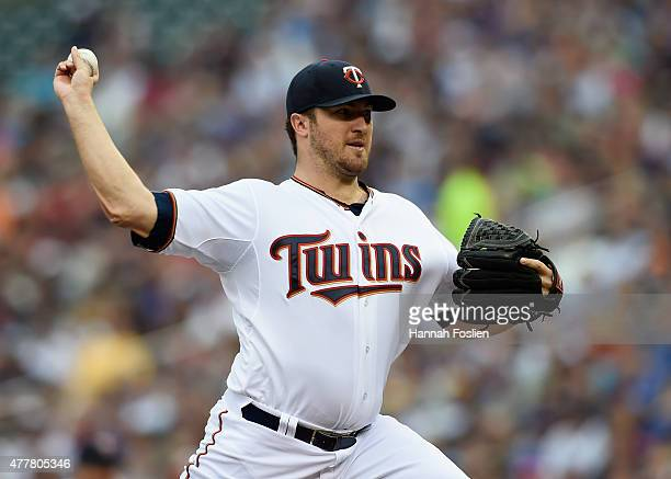 Phil Hughes of the Minnesota Twins delivers a pitch against the Chicago Cubs during the first inning of the game on June 19 2015 at Target Field in...