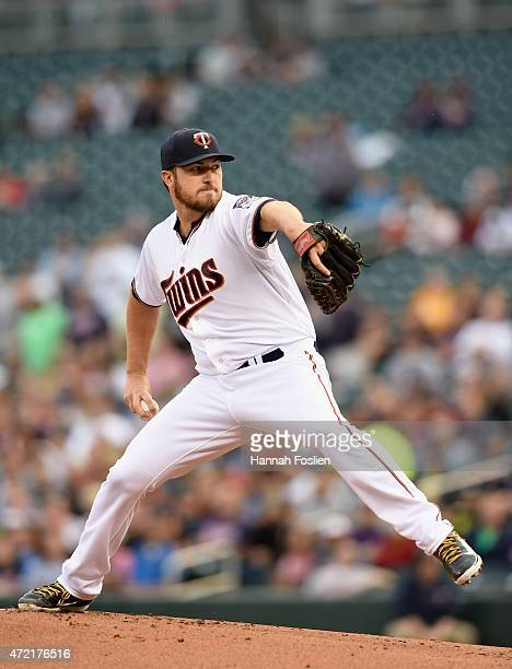 Phil Hughes of the Minnesota Twins delivers a pitch against the Oakland Athletics during the first inning of the game on May 4 2015 at Target Field...