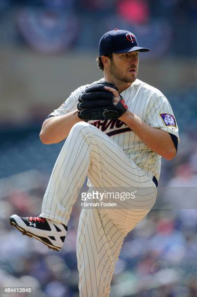 Phil Hughes of the Minnesota Twins delivers a pitch against the Oakland Athletics during the game on April 9 2014 at Target Field in Minneapolis...
