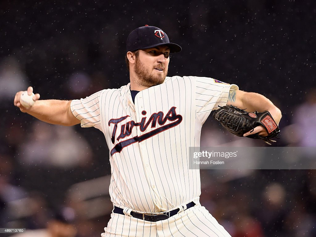 Phil Hughes of the Minnesota Twins delivers a pitch against the Cleveland Indians during the first inning of the game on September 23 2015 at Target...
