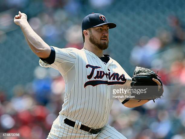 Phil Hughes of the Minnesota Twins delivers a pitch against the Boston Red Sox during the first inning of the game on May 27 2015 at Target Field in...