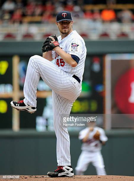 Phil Hughes of the Minnesota Twins delivers a pitch against the Chicago White Sox during the first inning of the game on June 22 2014 at Target Field...