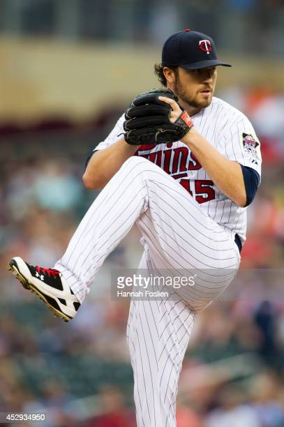 Phil Hughes of the Minnesota Twins delivers a pitch against the Chicago White Sox during the game on July 24 2014 at Target Field in Minneapolis...