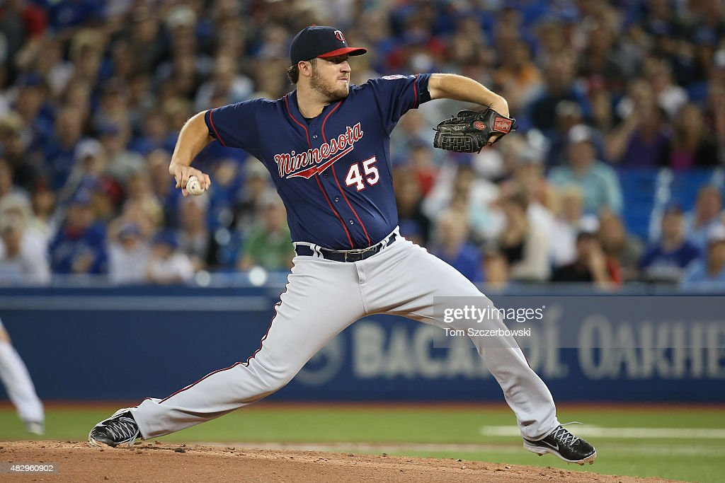 Phil Hughes of the Minnesota Twins delivers a pitch in the first inning during MLB game action against the Toronto Blue Jays on August 4 2015 at...