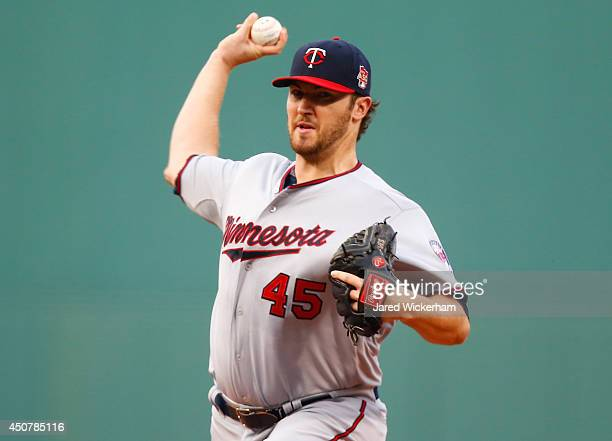 Phil Hughes of the Minnesota Twins pitches against the Boston Red Sox in the first inning during the game at Fenway Park on June 17 2014 in Boston...