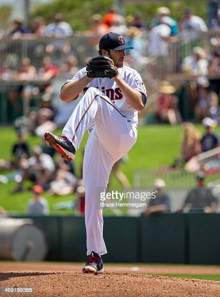 Phil Hughes of the Minnesota Twins pitches against the Miami Marlins at the CenturyLink Sports Complex on March 12 2015 in Fort Myers Florida
