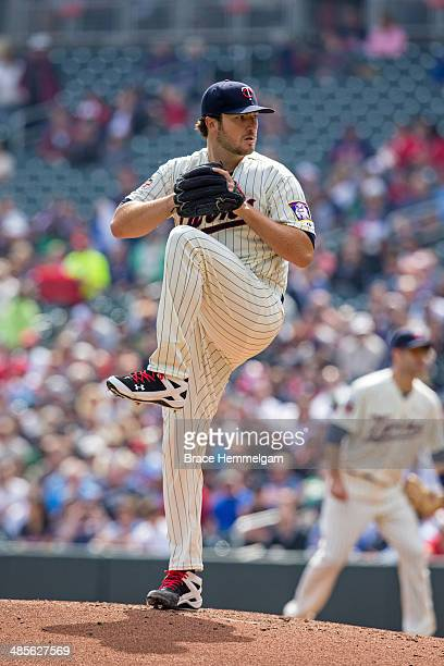 Phil Hughes of the Minnesota Twins pitches against the Oakland Athletics on April 9 2014 at Target Field in Minneapolis Minnesota The Athletics...