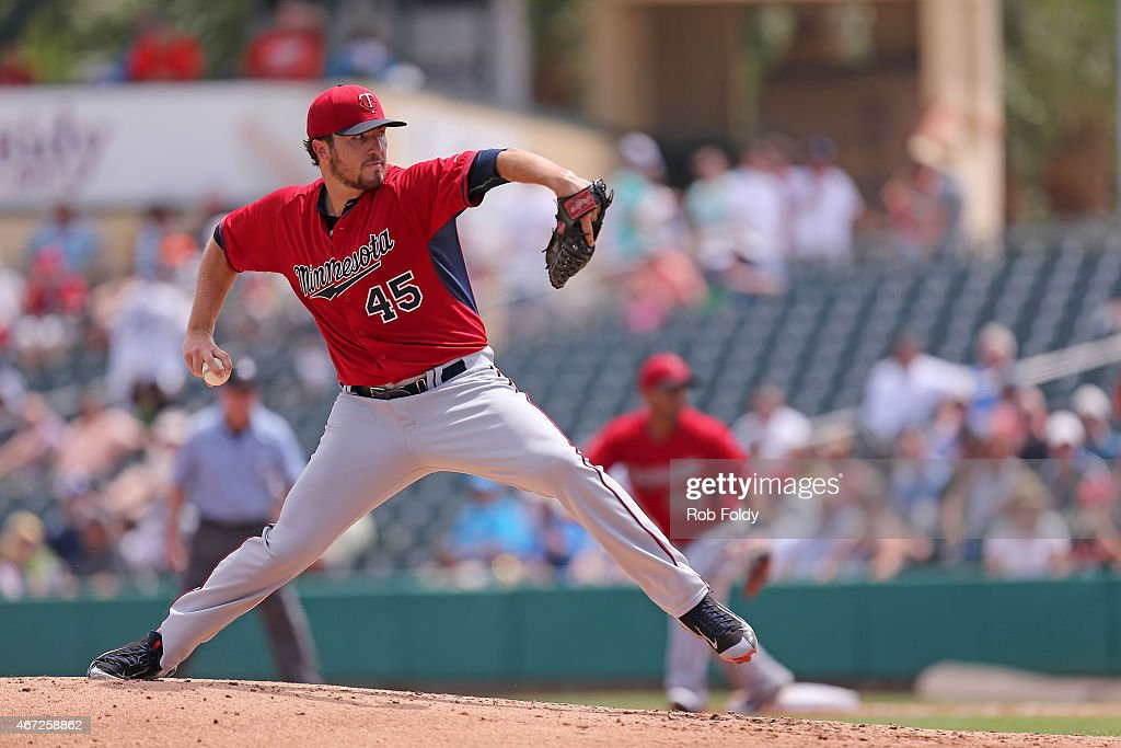 Phil Hughes of the Minnesota Twins pitches during the second inning of the game against the Miami Marlins at Roger Dean Stadium on March 22 2015 in...