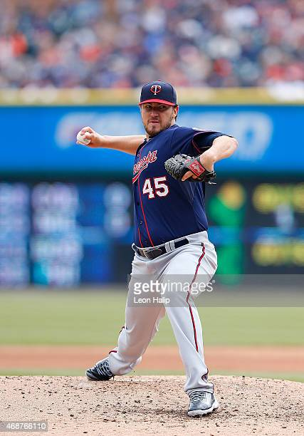 Phil Hughes of the Minnesota Twins pitches in the fifth inning of the Opening Day game against the Detroit Tigers at Comerica Park on April 6 2015 in...