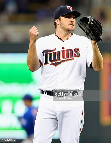 Phil Hughes of the Minnesota Twins reacts as Anthony Rizzo of the Chicago Cubs rounds the bases after hitting a solo home run during the fourth...