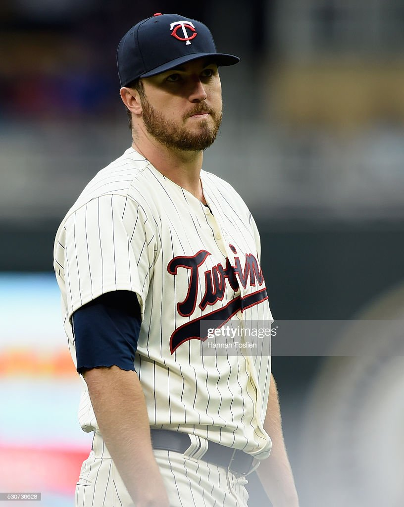 Phil Hughes of the Minnesota Twins reacts to giving up a tworun home run to Mark Trumbo of the Baltimore Orioles during the second inning of the game...