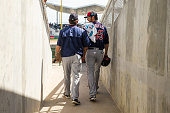 Phil Hughes of the Minnesota Twins takes the field with pitching coach Neil Allen against the Boston Red Sox during a spring training game on March 2...