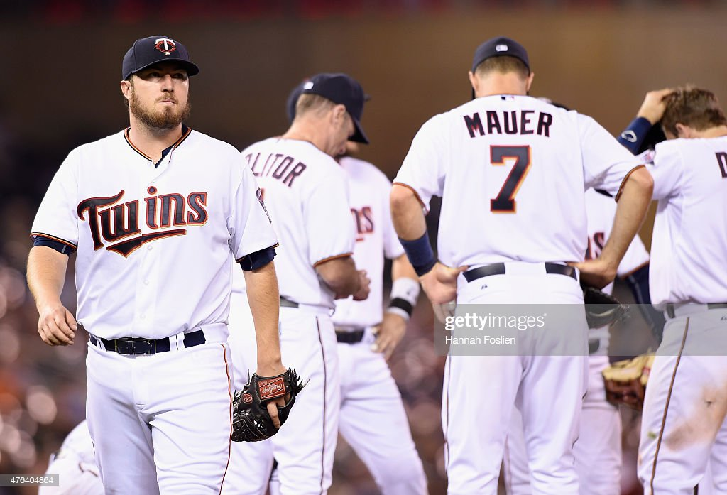 Phil Hughes #45 of the Minnesota Twins walks off the mound after manager Paul Molitor #4 pulled him during the eighth inning of the game against the Kansas City Royals on June 8, 2015 at Target Field in Minneapolis, Minnesota. The Royals defeated the Twins 3-1.