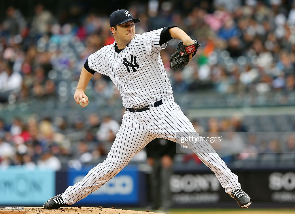 Phil Hughes #65 of the New York Yankees delivers a pitch against the Baltimore Orioles on April 13, 2013 at Yankee Stadium in the Bronx borough of New York City.