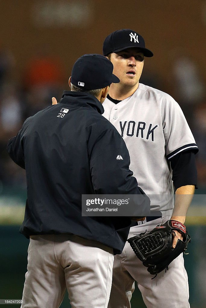 Phil Hughes #65 of the New York Yankees is taken out of the game by manager Joe Girardi #28 in the bottom of the ofurth inning against the Detroit Tigers during game three of the American League Championship Series at Comerica Park on October 16, 2012 in Detroit, Michigan.