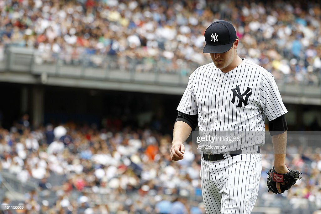Phil Hughes #65 of the New York Yankees reacts after giving up a three-run home run to Mark Reynolds #12 of the Baltimore Orioles at Yankee Stadium on September 2, 2012 in the Bronx borough of New York City.