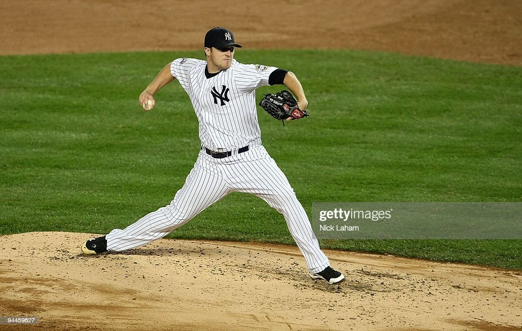 Phil Hughes of the New York Yankees throws a pitch against the Philadelphia Phillies in Game One of the 2009 MLB World Series at Yankee Stadium on...
