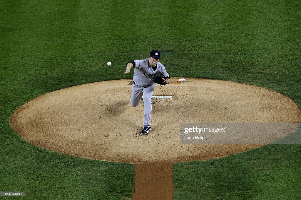 Phil Hughes #65 of the New York Yankees throws a pitch against the Detroit Tigers during game three of the American League Championship Series at Comerica Park on October 16, 2012 in Detroit, Michigan.