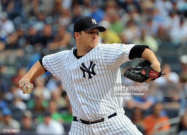 Phil Hughes of the New York Yankees throws a pitch in the top of the first inning against the Tampa Bay Rays at Yankee Stadium on August 13 2011 in...