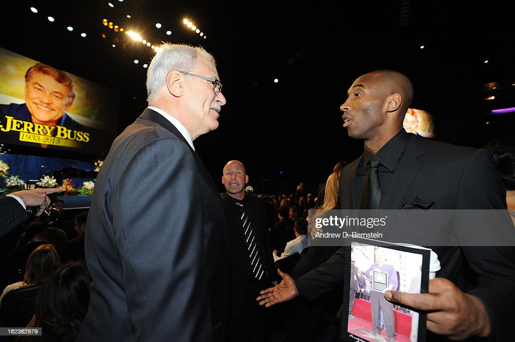 Phil Jackson and Kobe Bryant speak before the memorial service for Los Angeles Lakers Owner Dr. Jerry Buss at Nokia Theatre LA LIVE on February 21, 2013 in Los Angeles, California.