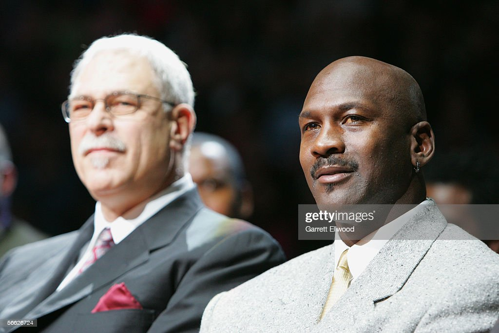 Phil Jackson and Michael Jordan watch the ceremony retiring the jersey of Scottie Pippen during the Chicago Bulls game the Los Angeles Lakers on...
