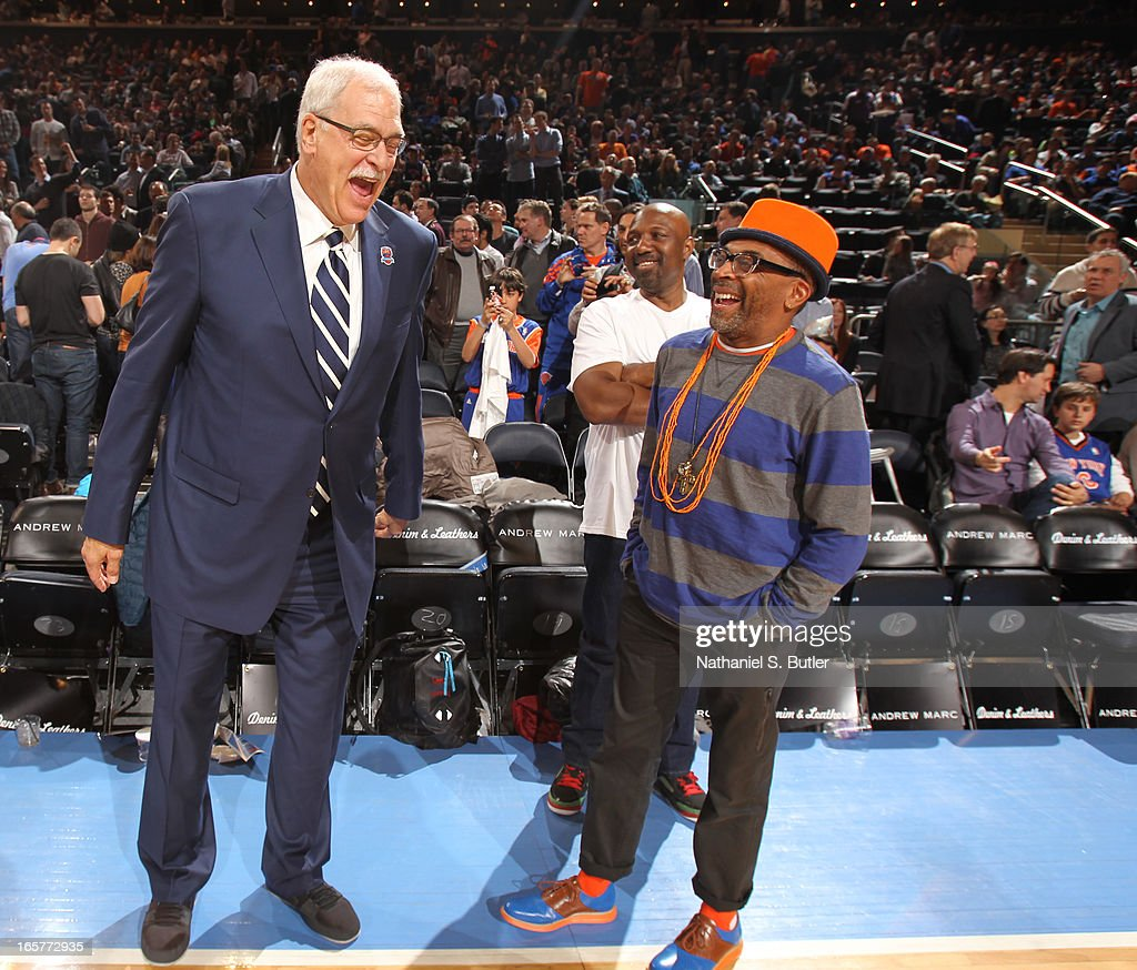 Phil Jackson and Spike Lee share a laugh before the game between the New York Knicks and the Milwaukee Bucks on April 5, 2013 at Madison Square Garden in New York City.