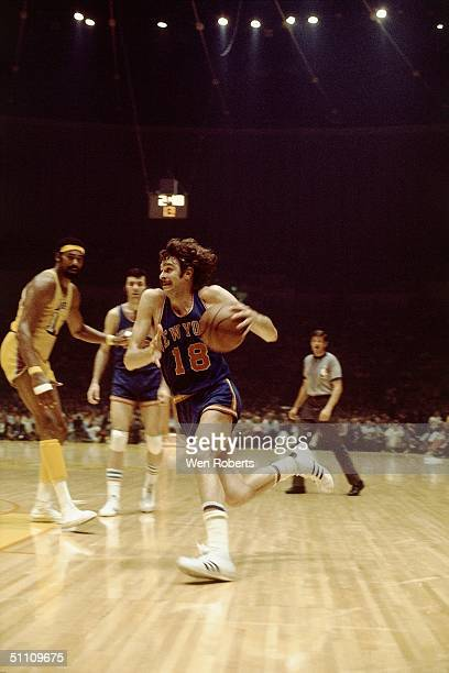 Phil Jackson of the New York Knicks dribbles the ball to the basket past Wilt Chamberlain of the Los Angeles Lakers circa 1970 at the Forum in Los...