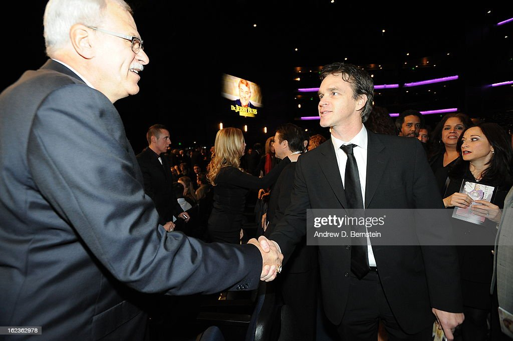 Phil Jackson shakes hands with Luc Robitaille before the memorial service for Los Angeles Lakers Owner Dr. Jerry Buss at Nokia Theatre LA LIVE on February 21, 2013 in Los Angeles, California.