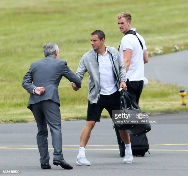 Phil Jagielka and Joe Hart on the runway at the Manchester Airport Manchester