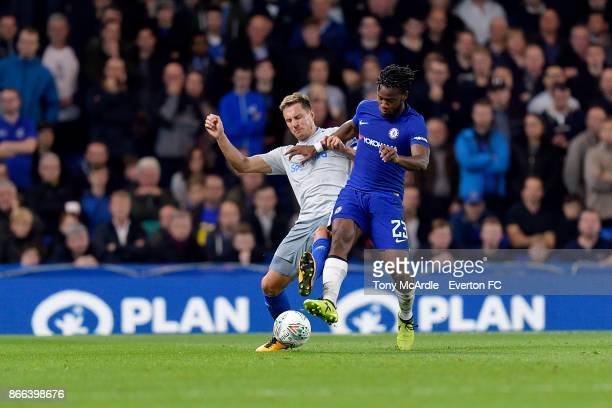 Phil Jagielka and Michy Batshuayi challenge for the ball during the Carabao Cup Fourth Round match between Chelsea and Everton at Stamford Bridge on...