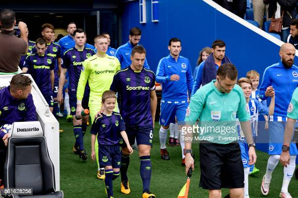 Phil Jagielka leads out his Everton team during the Premier League match between Brighton and Hove Albion and Everton at Amex Stadium on October 15...