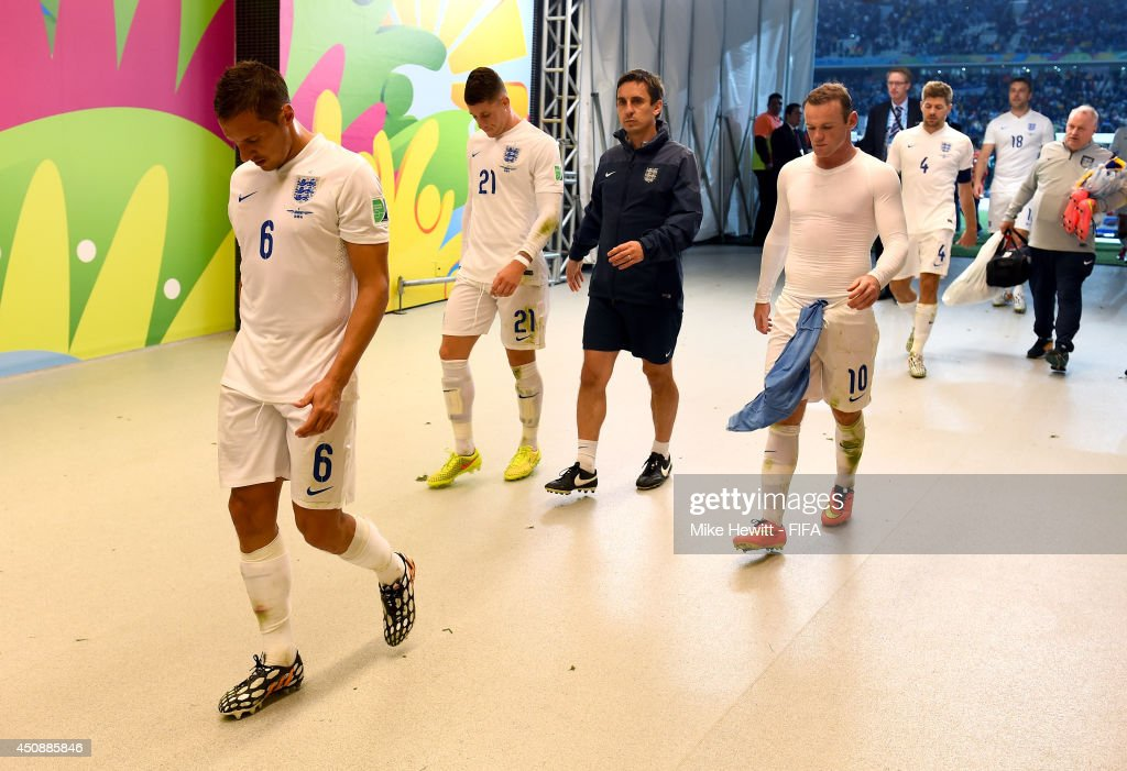 Phil Jagielka of England and England players walk in the tunnel to the dressing room after 2-1 defeat by Uruguay in the 2014 FIFA World Cup Brazil Group D match between Uruguay and England at Arena de Sao Paulo on June 19, 2014 in Sao Paulo, Brazil.
