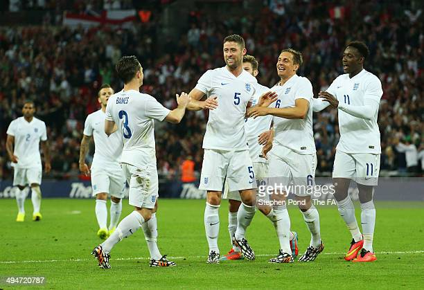 Phil Jagielka of England celebrates with team mates as he scores their third goal during the International Friendly match between England and Peru at...