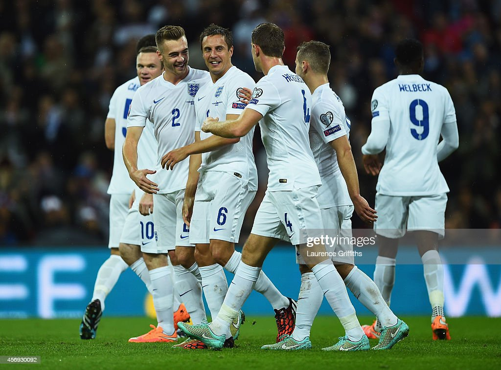 <a gi-track='captionPersonalityLinkClicked' href=/galleries/search?phrase=Phil+Jagielka&family=editorial&specificpeople=682518 ng-click='$event.stopPropagation()'>Phil Jagielka</a> of England (6) celebrates with team mates Calum Chambers (2) and <a gi-track='captionPersonalityLinkClicked' href=/galleries/search?phrase=Jordan+Henderson+-+Soccer+Player&family=editorial&specificpeople=4940390 ng-click='$event.stopPropagation()'>Jordan Henderson</a> (4) as he scores their irst goal during the EURO 2016 Group E Qualifying match between England and San Marino at Wembley Stadium on October 9, 2014 in London, England.